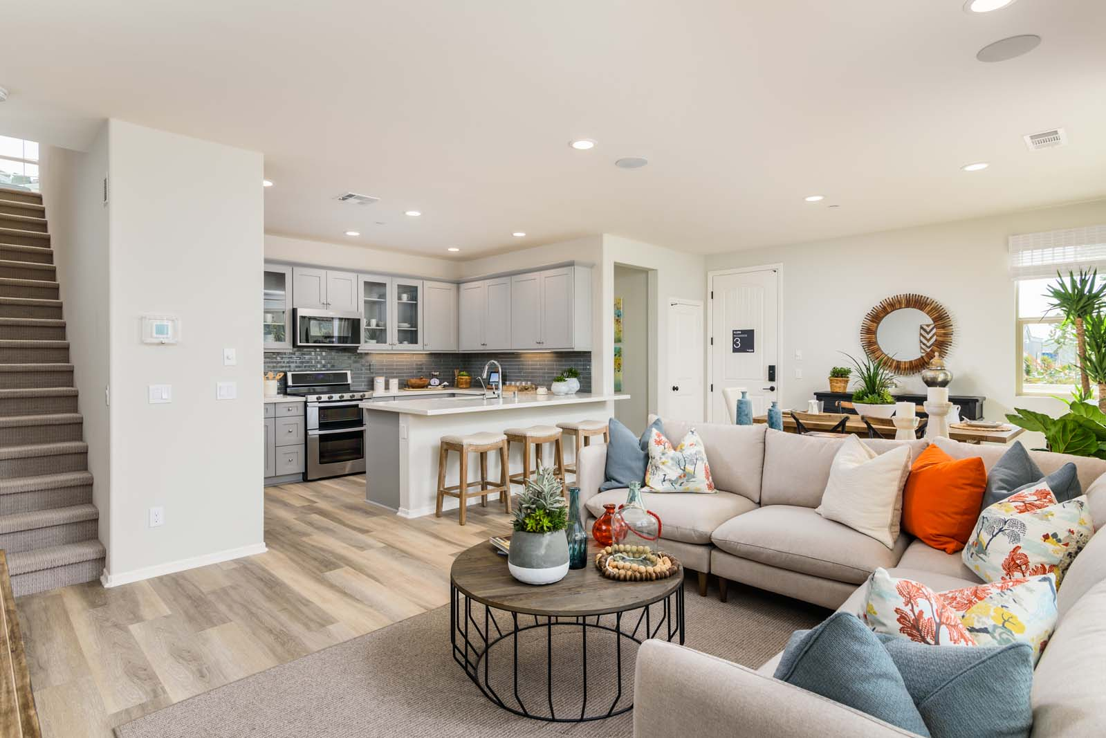Living area in new san diego townhome at Flora at the village of escaya