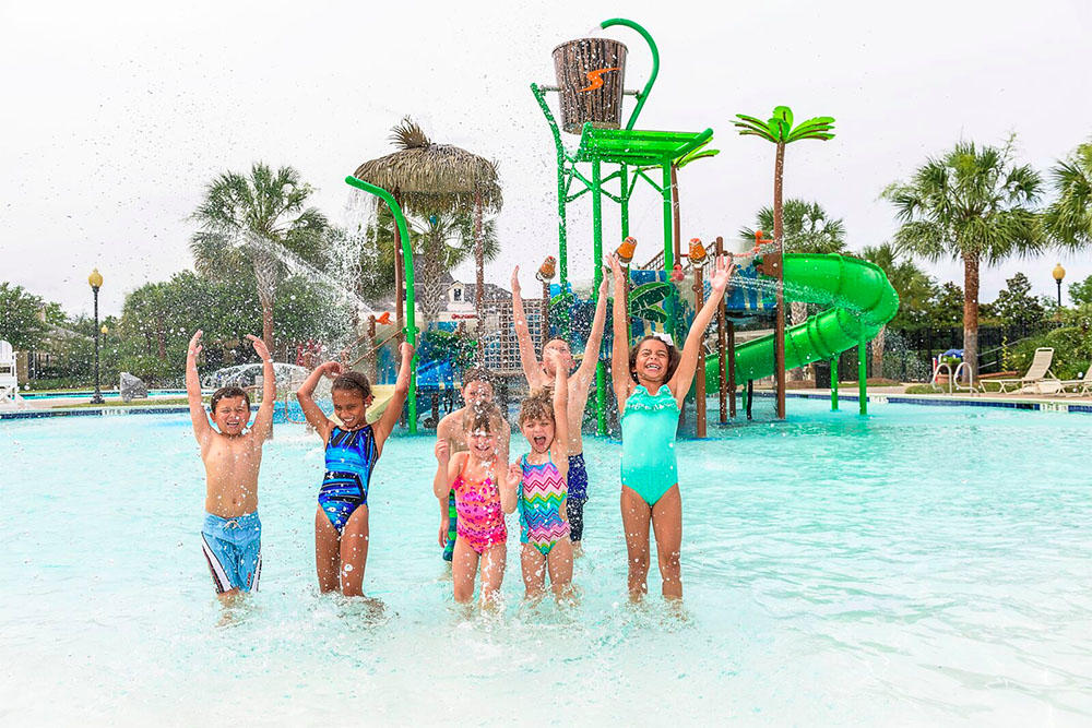 Children playing at waterpark in Sienna Plantation community