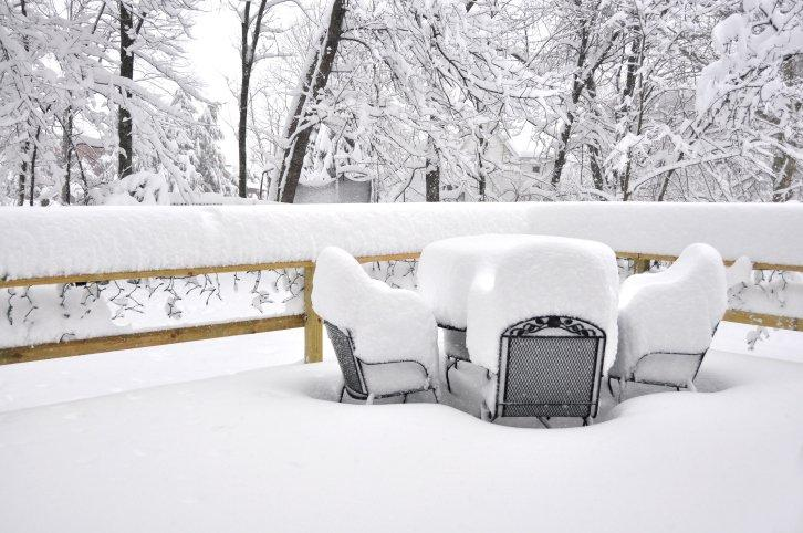 Patio set covered in snow